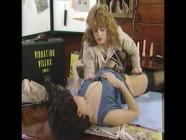 Two women fuck  on a desk